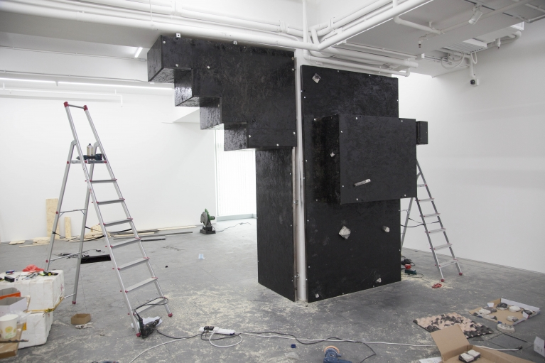 Andrew Luk, Black Square Problem Setting, 2017. Steel, wood, fiber glass resin, powder pigment, aquarium sand, installation in progress.