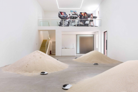 Mak Ying Tung 2, Mr. Fool Wants to Move the Mountains, 2018. Robotic vacuum cleaners, sand. Dimensions variable.