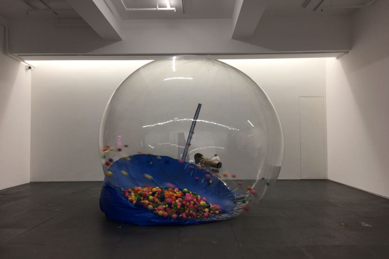 Mak Ying Tung, You Better Watch Out, 2017, Sponge balls, PVC plastic, inflatable snow globes, IP camera system, 218 x 330 x 260 cm