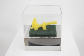Zhou Wendou, Sponge Pop - One Person on Seesaw, 2006, Sponge in acrylic box, 9 x 6 x 4.5 cm.