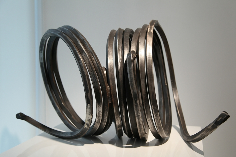 Bernar Venet, Three Indeterminate Lines, 1993, Rolled steel inscribed 'No. 0993' on the bottom, 36 x 46 x 57 cm